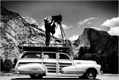 Ansel Adams on the roof of his car. (NY Times)