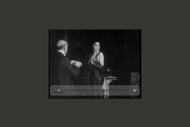 Still from an old film of de László painting a half-length portrait (click to go to the clip).