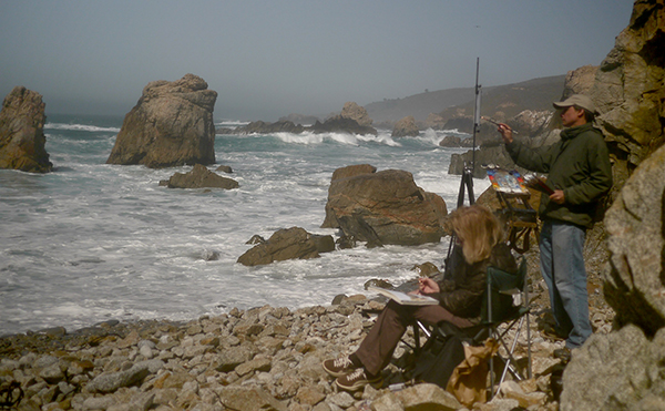 Plein air landscape painting in a Patagonia jacket, Big Sur, California.