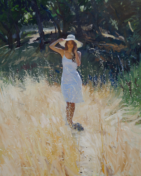 Plein air painting of a model standing in rye grass.