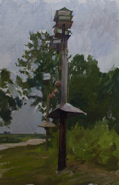 Plein air painting of birdhouses.