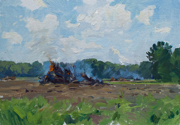 Plein air painting of burning stumps on a farm.