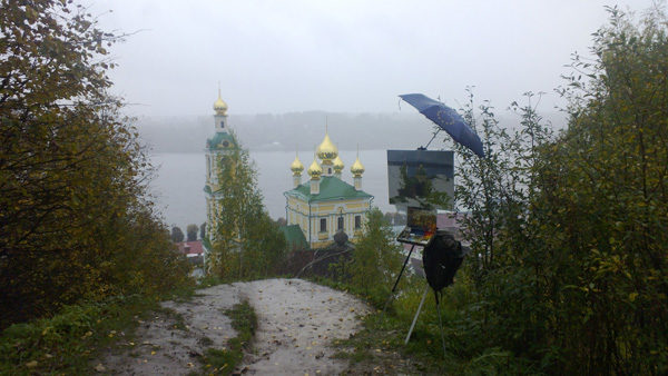 Plein air landscape painting in heavy persistent rain in Plyos, Russia.