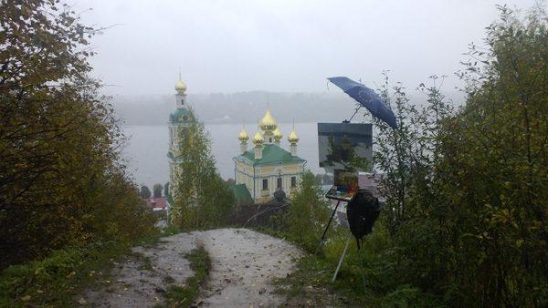 Plein air landscape painting in heavy persistent rain in Plyos, Russia.